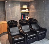 Comfortable and adjustable chairs at wash basins